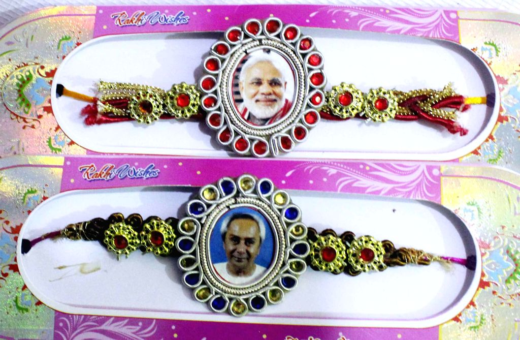 Rakhis with pictures of Prime Minister Narendra Modi and Odisha Chief Minister Naveen Patnaik on sale at a shop in Cuttack of Odisha on Aug 3, 2014. - Narendra Modi