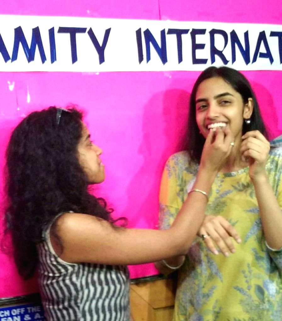 Raksha Gopal, who topped the Class 12 CBSE exams, the results of which were declared on May 28, 2017 celebrates with her achievement in Noida.