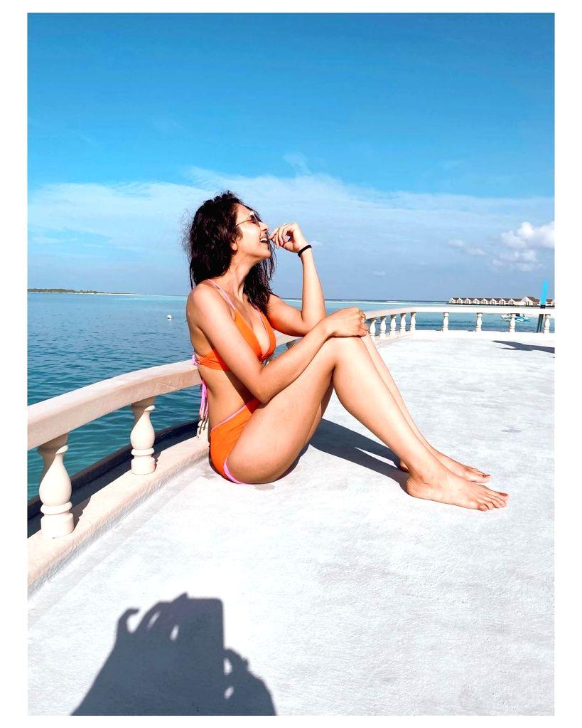 Rakul Preet Singh dazzles in orange bikini. - Rakul Preet Singh
