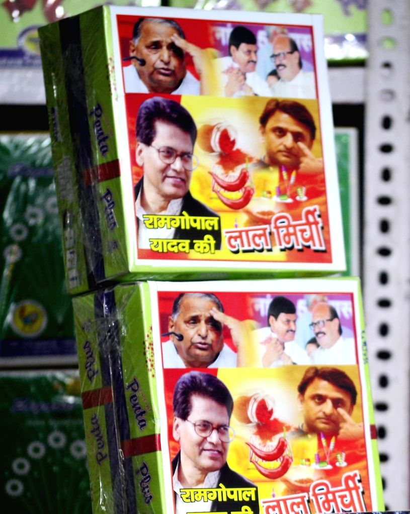 """Ram Gopal Yadav ki Lal Mirch bomb"""" brand crackers on display at a cracker shop in Allahabad on Oct 26, 2016. Crackers branded on other current events have also hit the shops ... - Gopal Yadav"""