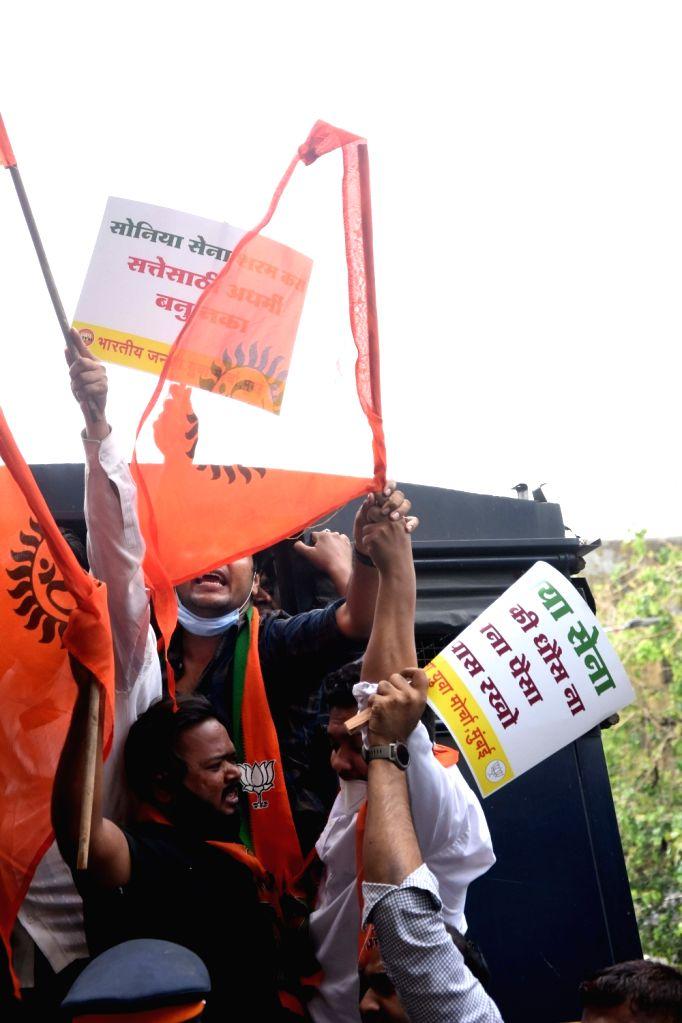 Ram Mandir land fund 'scam': Bharatiya Janata Yuva Morcha workers protest outside Shiv Sena Bhavan; 40 protestors detained at Dadar in Mumbai on Wednesday, 16 June, 2021.