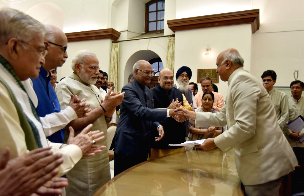 Ram Nath Kovind files his nomination papers for the Presidential Election, in the presence of Prime Minister Narendra Modi, BJP MP LK Advani and  and other dignitaries, at Parliament, in ... - Narendra Modi and Nath Kovind