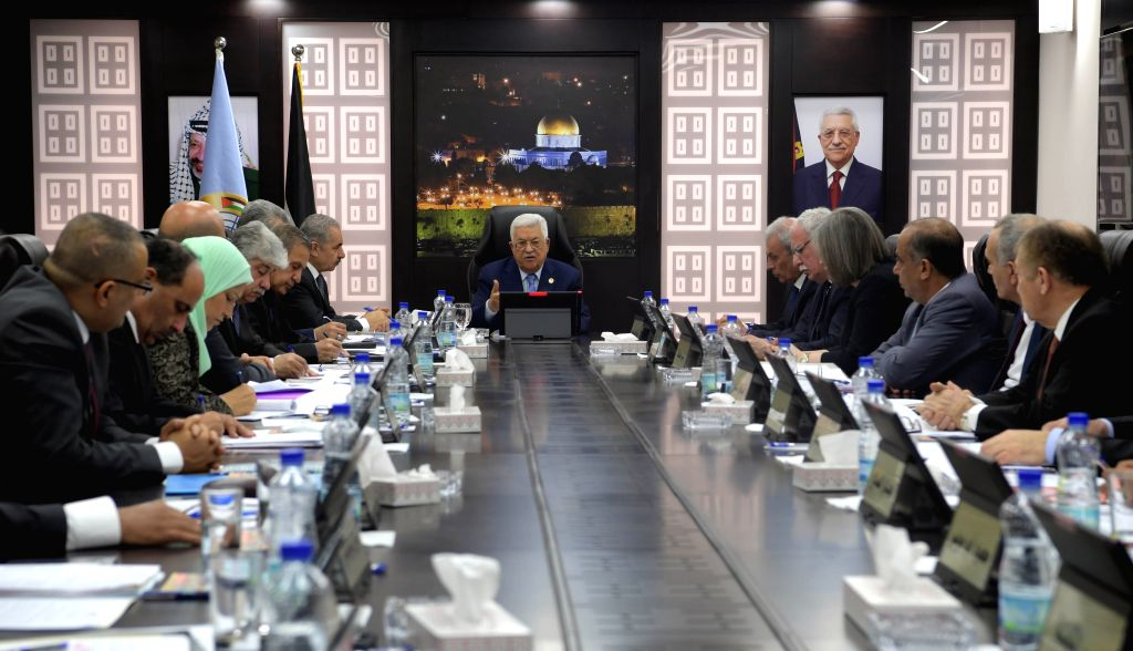 RAMALLAH, April 29, 2019 - Palestinian President Mahmoud Abbas (C) chairs a meeting of the newly formed Palestinian cabinet in the West Bank city of Ramallah, April 29, 2019. Abbas said on Monday ...