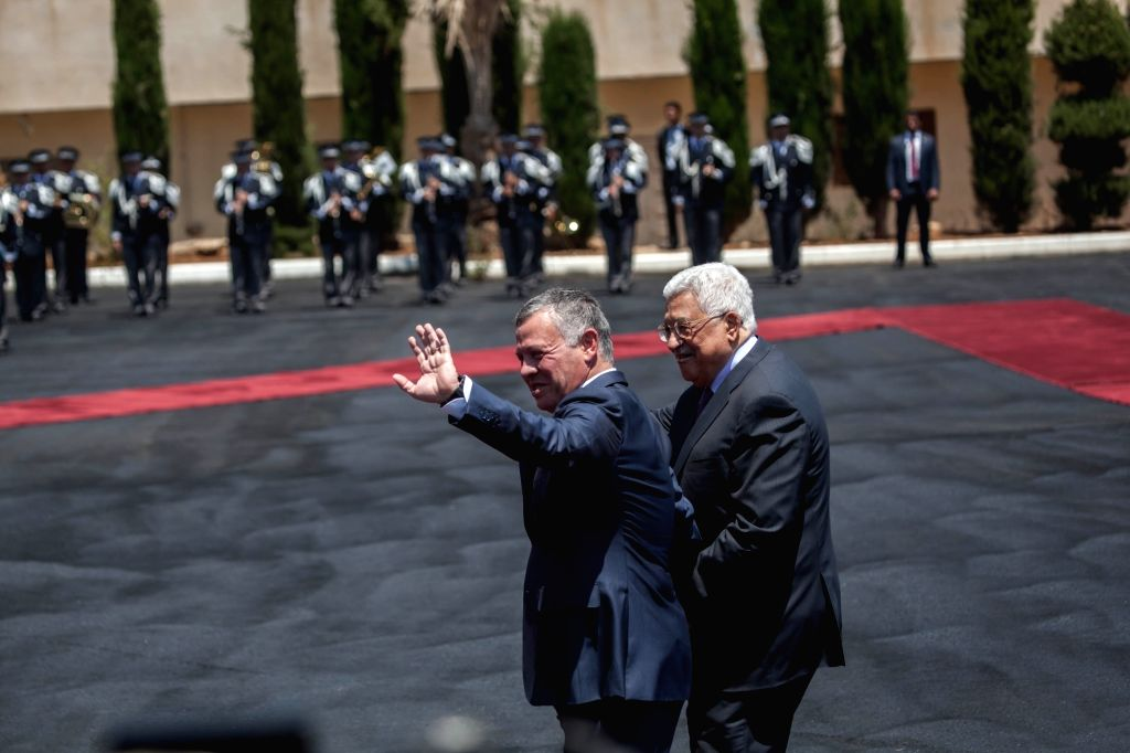 RAMALLAH, Aug. 07, 2017 - King Abdullah II of Jordan (L) waves as he is received by Palestinian President Mahmoud Abbas (R) in the West Bank city of Ramallah on Aug. 7, 2017.
