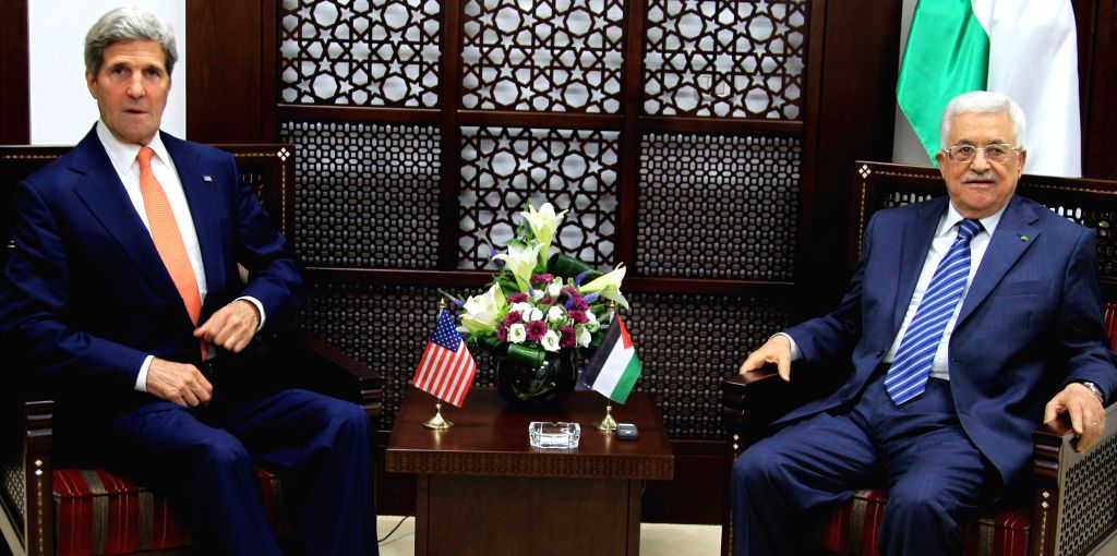 U.S. Secretary of State John Kerry (L) meets with Palestinian President Mahmoud Abbas in the west bank city of Ramallah on July 23, 2014. Kerry is meeting with ...
