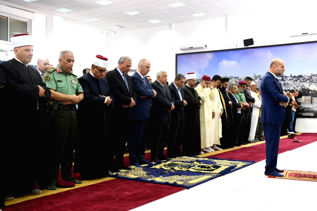 RAMALLAH, June 25, 2017 - Palestinian President Mahmoud Abbas (6th L) attends the Eid Al-Fitr prayer at the Presidency compound in the West Bank city of Ramallah on June 25, 2017. (Xinhua/Pool/Office ...