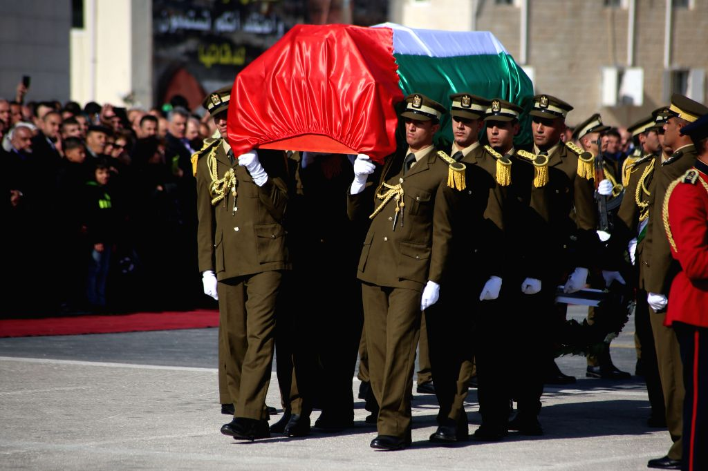 Palestinian honor guard carries the coffin during the funeral procession of the late Palestinian cabinet member Ziad Abu Ain at the Palestinian Authority headquarters in the West Bank city .