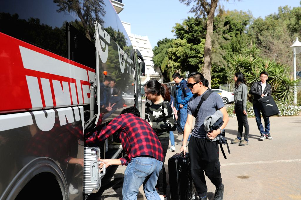 RAMAT GAN, Nov. 25, 2016 - Chinese students load luggages during an evacuation in Ramat Gan, Israel, on Nov. 25, 2016. A total of 159 Chinese students threatened by bushfires that rage in Israel were ...