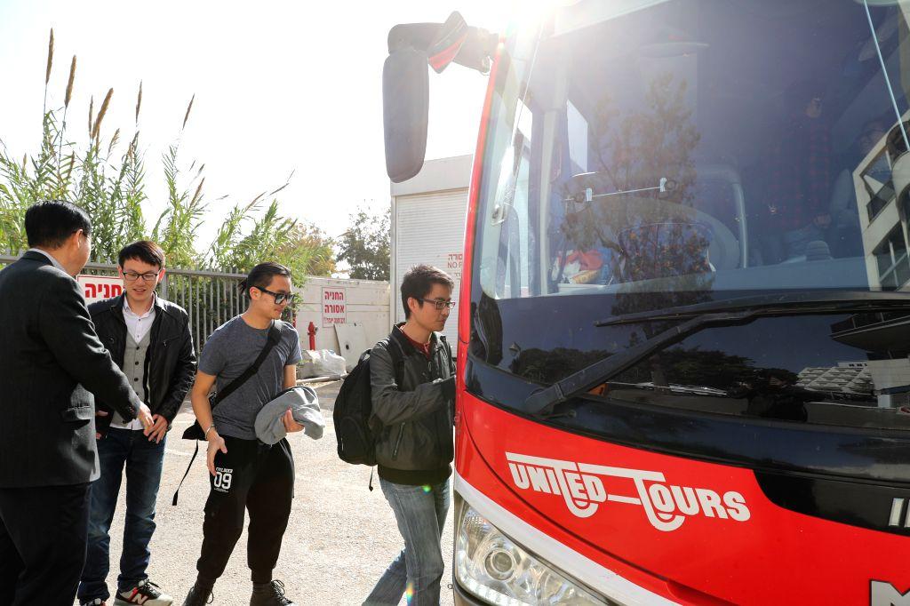 RAMAT GAN, Nov. 25, 2016 - Chinese students take bus during an evacuation in Ramat Gan, Israel, on Nov. 25, 2016. A total of 159 Chinese students threatened by bushfires that rage in Israel were ...