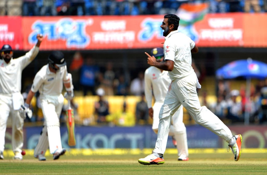 Ramchandra Ashwin of India celebrates fall of New Zealand captain Kane Williamson's wicket  on the third day of the third test match between India and New Zealand at Holkar stadium in Indore ... - Kane Williamso