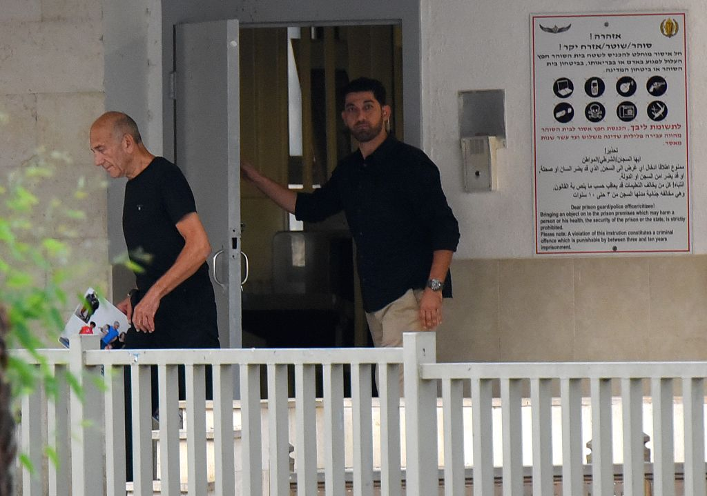 RAMLE, July 2, 2017 - Former Israeli Prime Minister Ehud Olmert (L) exits from Maasiyahu prison near Ramle, central Israel, on July 2, 2017. Former Israeli prime minister Ehud Olmert was released ... - Ehud Olmert