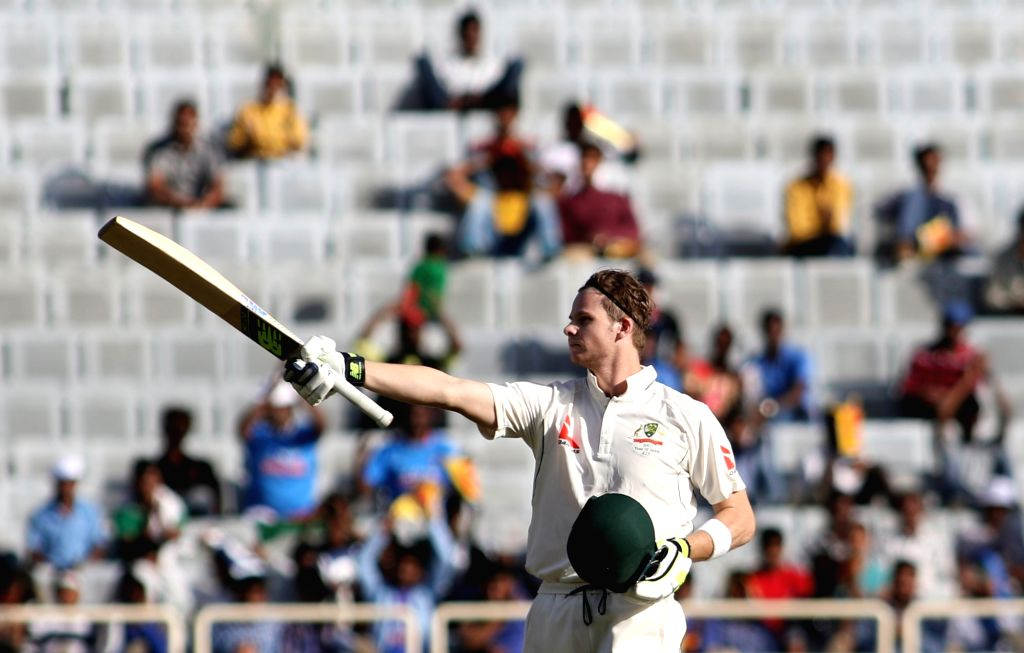 Ranchi: Australian captain Steve Smith raises his bat after scoring century during the first day of the third cricket test match between India and Australia at the Jharkhand State Cricket Association (JSCA) Stadium complex in Ranchi on March 16, 2017 - Steve Smith and Surjeet Yadav