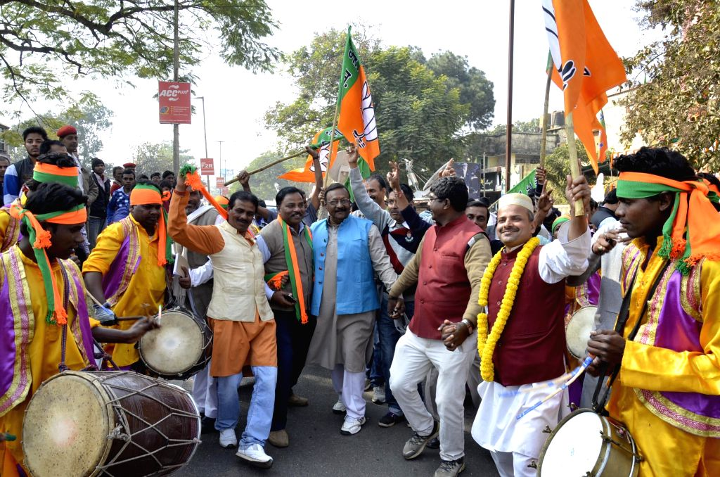BJP workers celebrate party`s performance in the recently concluded Jharkhand Assembly polls in Ranchi, Jharkhand on Dec 23, 2014.