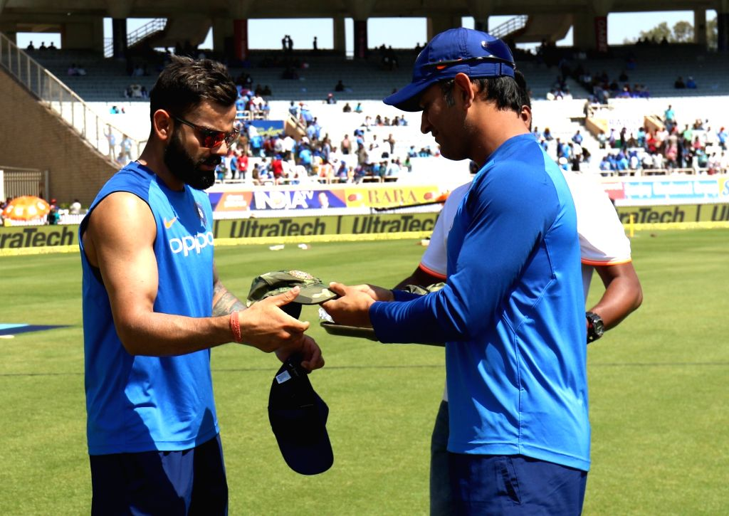 Ranchi: India's MS Dhoni presents a camouflage cap to captain Virat Kohli ahead of the third ODI match against Australia at JSCA International Stadium Complex in Ranchi on March 8, 2019. 'Men in Blue' will be wearing the camouflaged caps to pay tribu - Virat Kohli, MS Dhoni and Surjeet Yadav