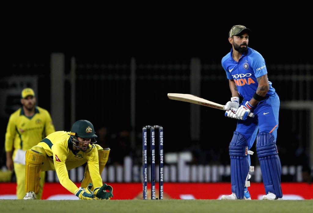 Ranchi: India's Virat Kohli in action during the third ODI match between India and Australia at JSCA International Stadium Complex in Ranchi on March 8, 2019. (Photo: Surjeet Yadav/IANS) - Virat Kohli and Surjeet Yadav