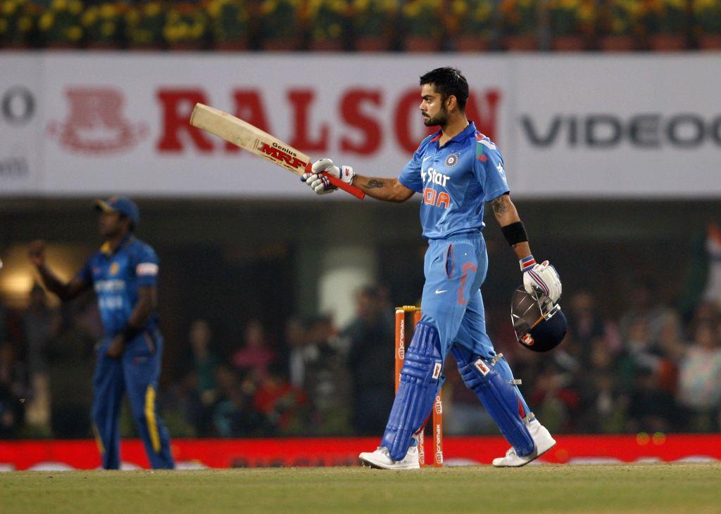 Indian captain Virat Kohli celebrates his century during the 5th ODI between India and Sri Lanka at JSCA International Stadium Complex, in Ranchi on Nov 16, 2014. - Virat Kohli