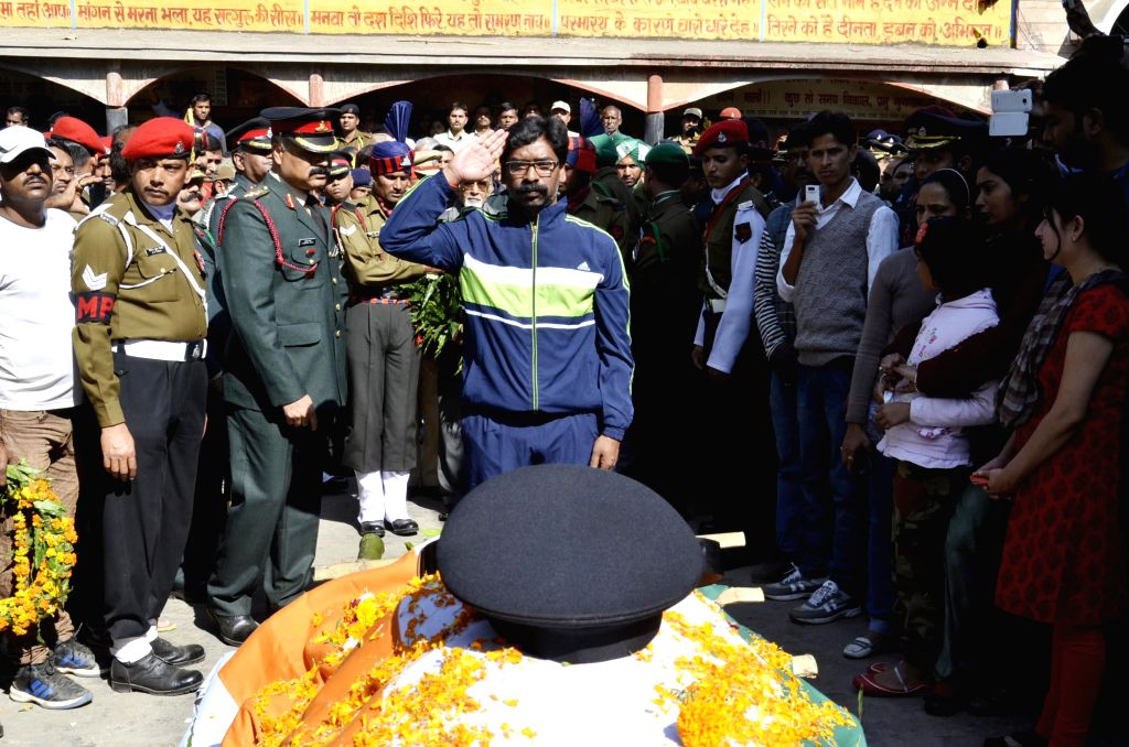 Jharkhand Chief Minister Hemant Soren pays last respect to Lieutenant Colonel Sankalp Shukla who was killed in a militant attack in Jammu and Kashmir in Ranchi, on Dec 7, 2014. - Hemant Soren