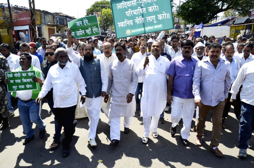 Jharkhand Mukti Morcha (JMM) legislators led by the leader of opposition in Jharkhand assembly stage a demonstration against the land acquisition bill in Ranchi on March 20, 2015.