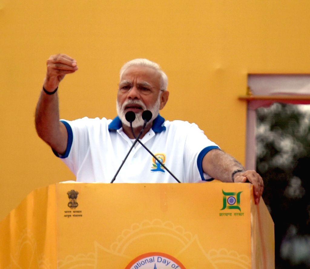 Ranchi: Prime Minister Narendra Modi addresses during International Yoga Day 2019 celebrations at Prabhat Tara Maidan in Ranchi on June 21, 2019. (Photo: IANS) - Narendra Modi