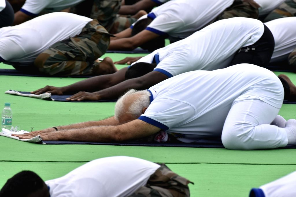 Ranchi: Prime Minister Narendra Modi practices yoga asanas -postures- on International Yoga Day 2019 at Prabhat Tara Maidan in Ranchi on June 21, 2019. (Photo: IANS) - Narendra Modi
