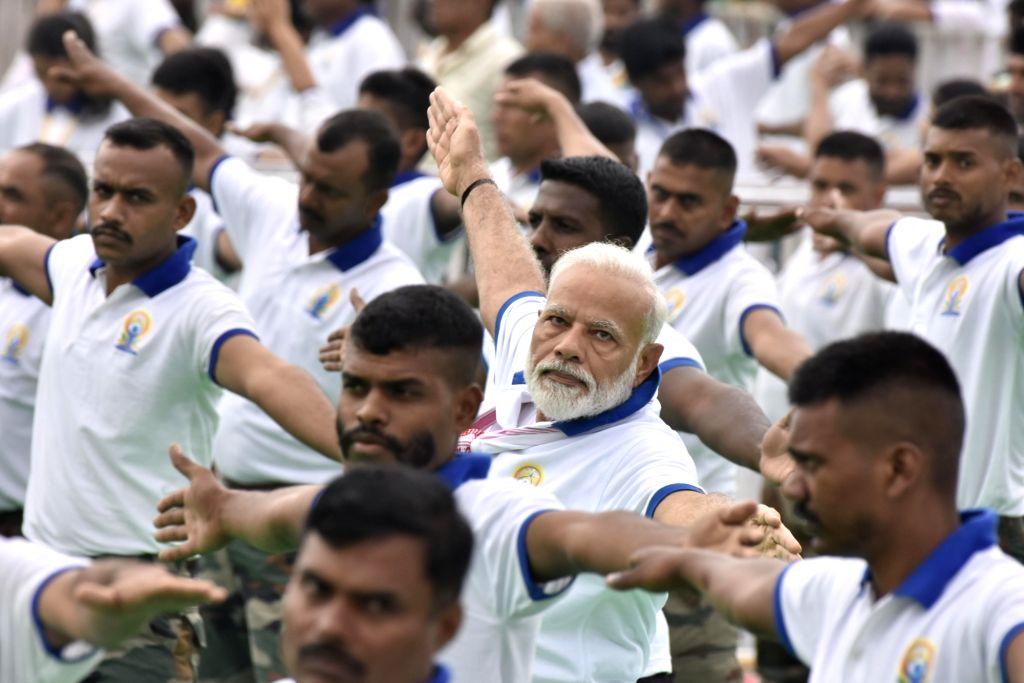 Ranchi: Prime Minister Narendra Modi practices yoga asanas -postures- on International Yoga Day 2019 at Prabhat Tara Maidan in Ranchi on June 21, 2019. (Photo: IANS) - Narendra Modi