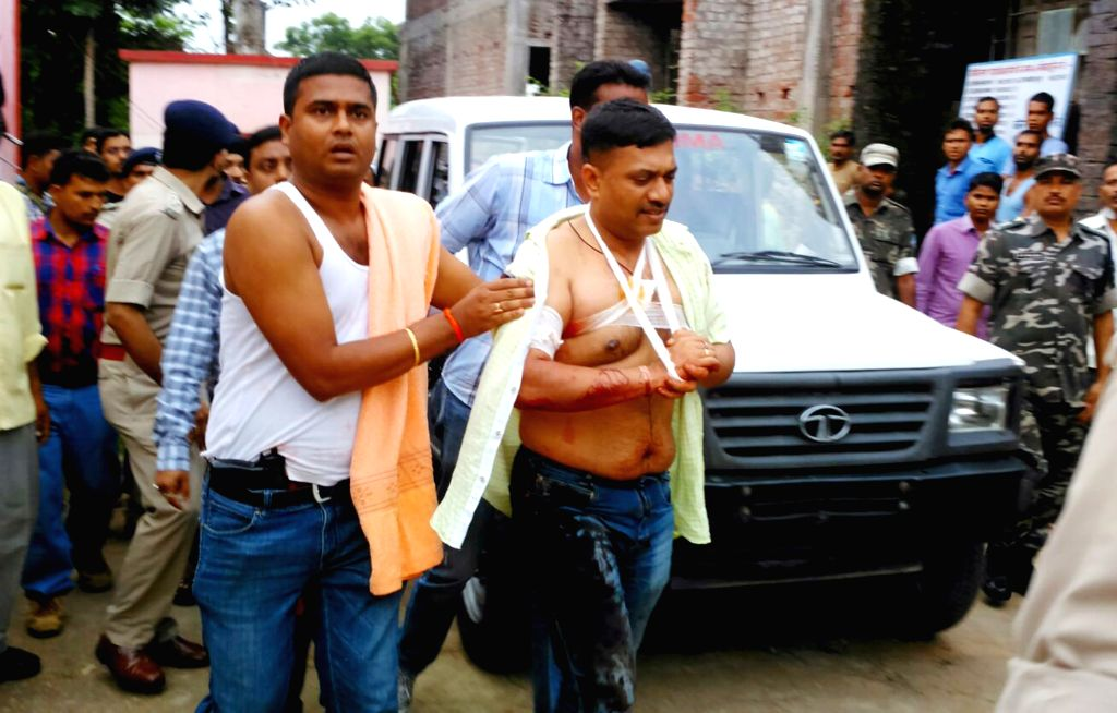 Ranchi Senior Superintendent of Police Prabhat Kumar, who was injured in a gunfight with Left wing extremists, being rushed to  hospital in Ranchi on Aug 18, 2015. The gun fight took place in ... - Prabhat Kumar