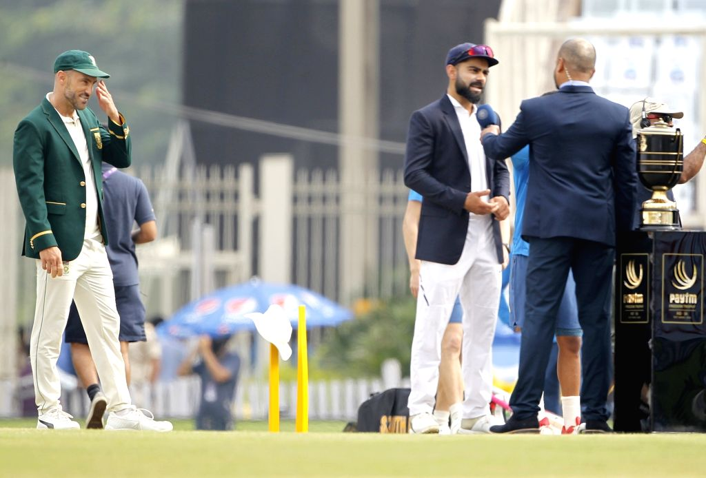 Ranchi: South African captain Faf du Plessis and Indian captain Virat Kohli at toss during the day one of 3rd Test  between India and South Africa in Ranchi on Oct. 19, 2019, (Photo: Surjeet Yadav/IANS) - Faf, Virat Kohli and Surjeet Yadav