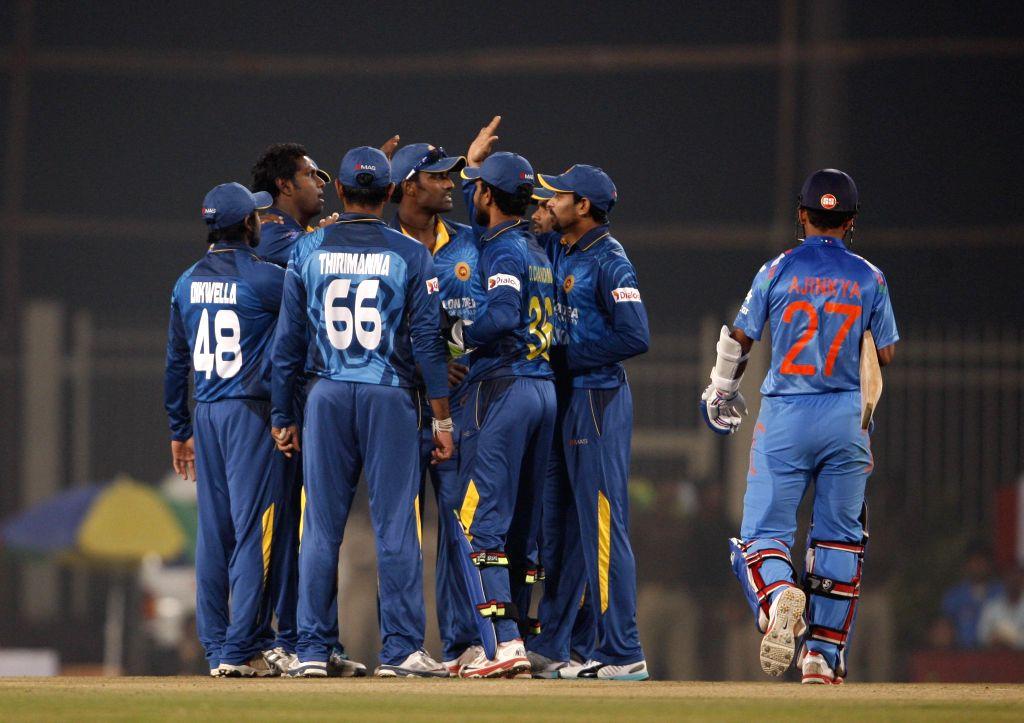 Sri Lankan players celebrate fall of Ajinkya Rahane's wicket during the 5th ODI between India and Sri Lanka at JSCA International Stadium Complex, in Ranchi on Nov 16, 2014.
