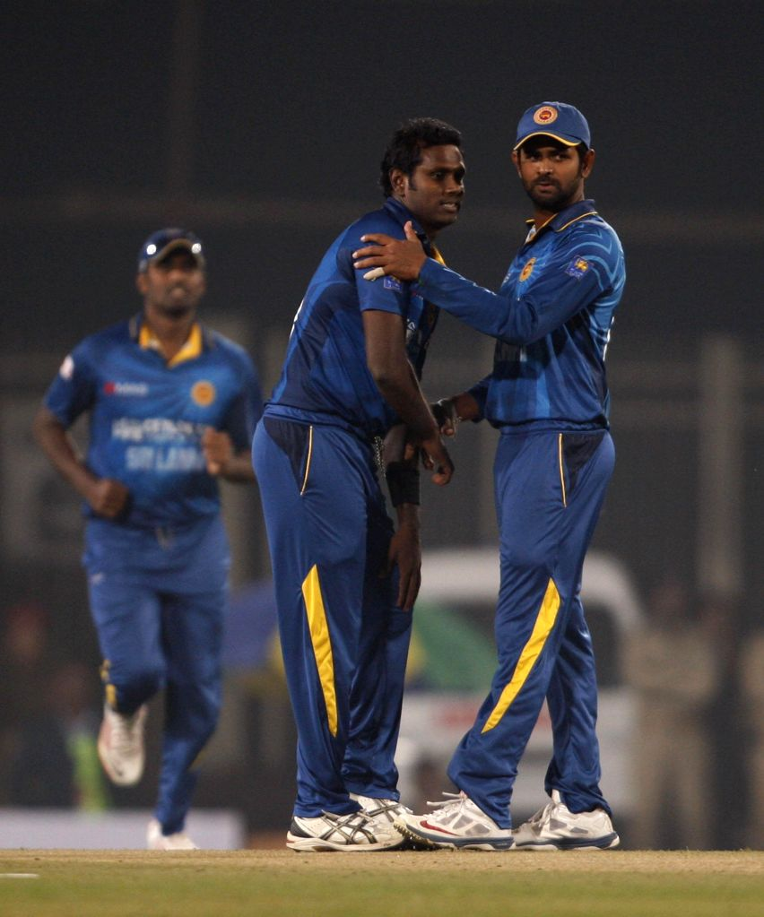 Sri Lankan players celebrate fall of a wicket during the 5th ODI between India and Sri Lanka at JSCA International Stadium Complex, in Ranchi on Nov 16, 2014.