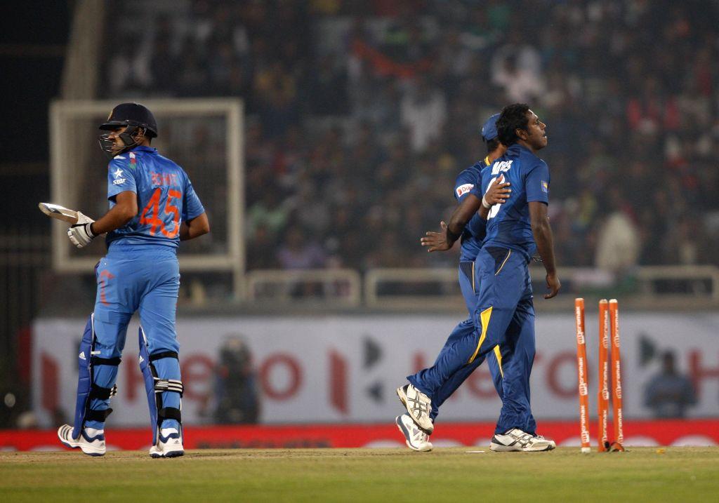 Sri Lankan players celebrate fall of Rihit Sharma's wicket during the 5th ODI between India and Sri Lanka at JSCA International Stadium Complex, in Ranchi on Nov 16, 2014. - Rihit Sharma