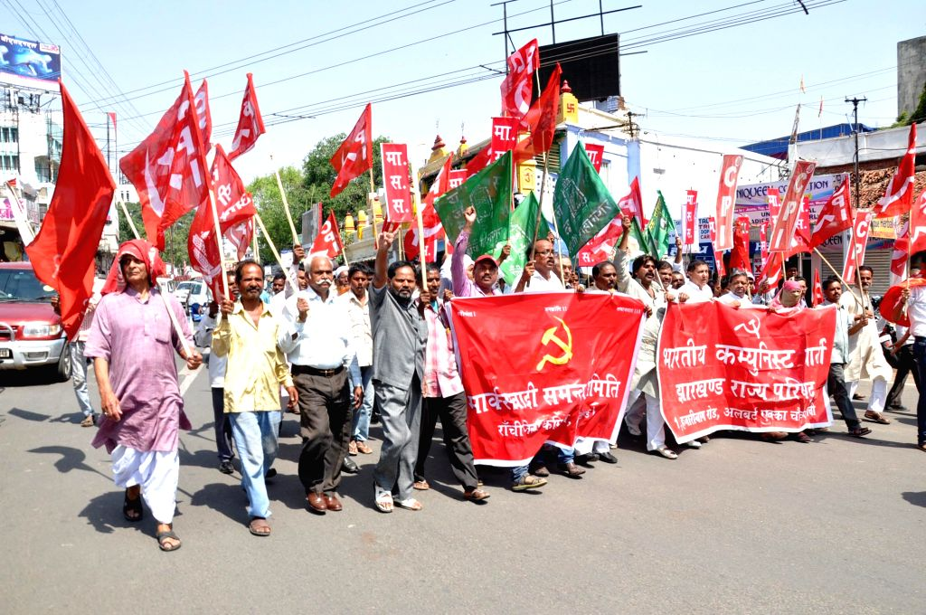 The workers of the Jharkhand Vikas Morcha (Prajatantrik) and the CPI participate in a rally organised during the state-wide strike called by the duo against land acquisition ordinance in ...