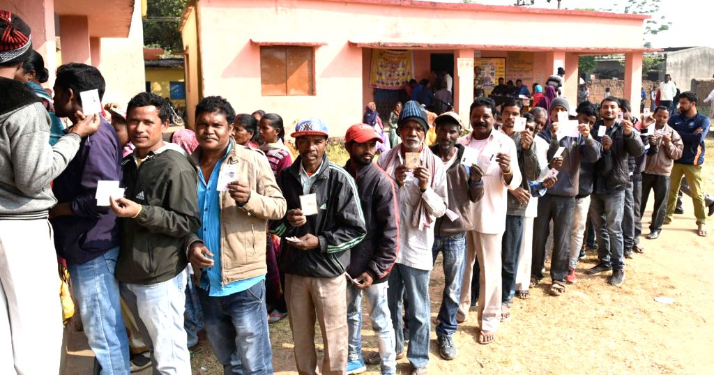 Ranchi: Voters queue up to cast their votes at Government Middle School, Murma, Nagri during the 3rd phase of Jharkhand Assembly Elections, in Ranchi on Dec 12, 2019. (Photo: IANS/PIB)
