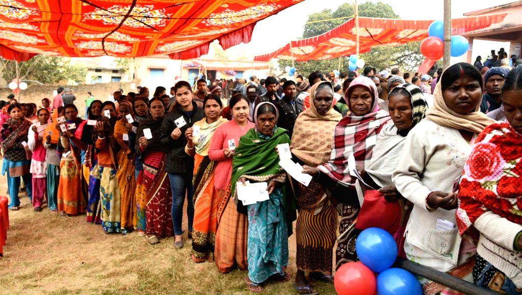 Ranchi: Voters queue up to cast their votes at Government Primary School Kamre, Kanke during the 3rd phase of Jharkhand Assembly Elections, in Ranchi on Dec 12, 2019. (Photo: IANS/PIB)