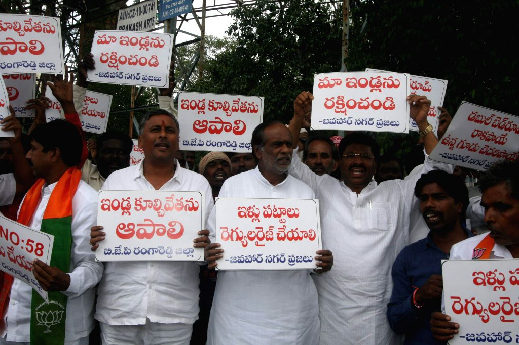 Ranga Reddy: BJP leaders stage a demonstration against demolition of illegal huts in Ranga Reddy district of Andhra Pradesh on Aug 3, 2015.