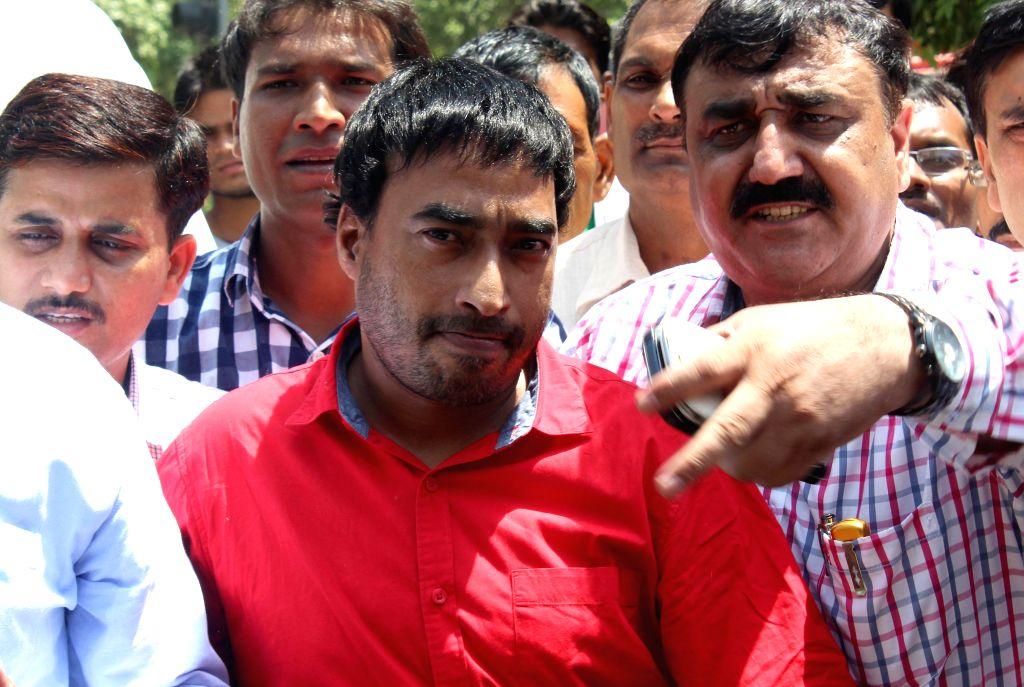 Ranjit Singh Kohli alias Raqibul Hasan Khan, the husband of national champion shooter Tara Shahdeo being taken to be produced at Dwarka Court in New Delhi on Aug 27, 2014.The shooter has alleged that - Ranjit Singh Kohli and Raqibul Hasan Khan
