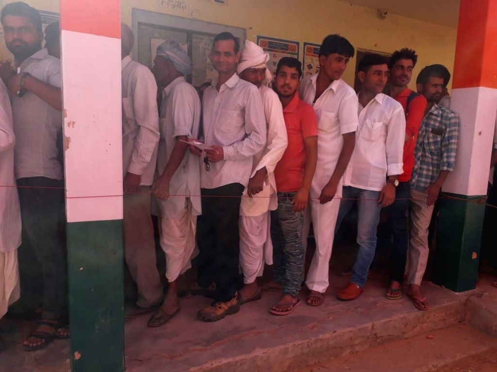 Ranwal : People stand in a queue to cast their vote at a polling station in Ranwal, Rajasthan on May 6, 2019.