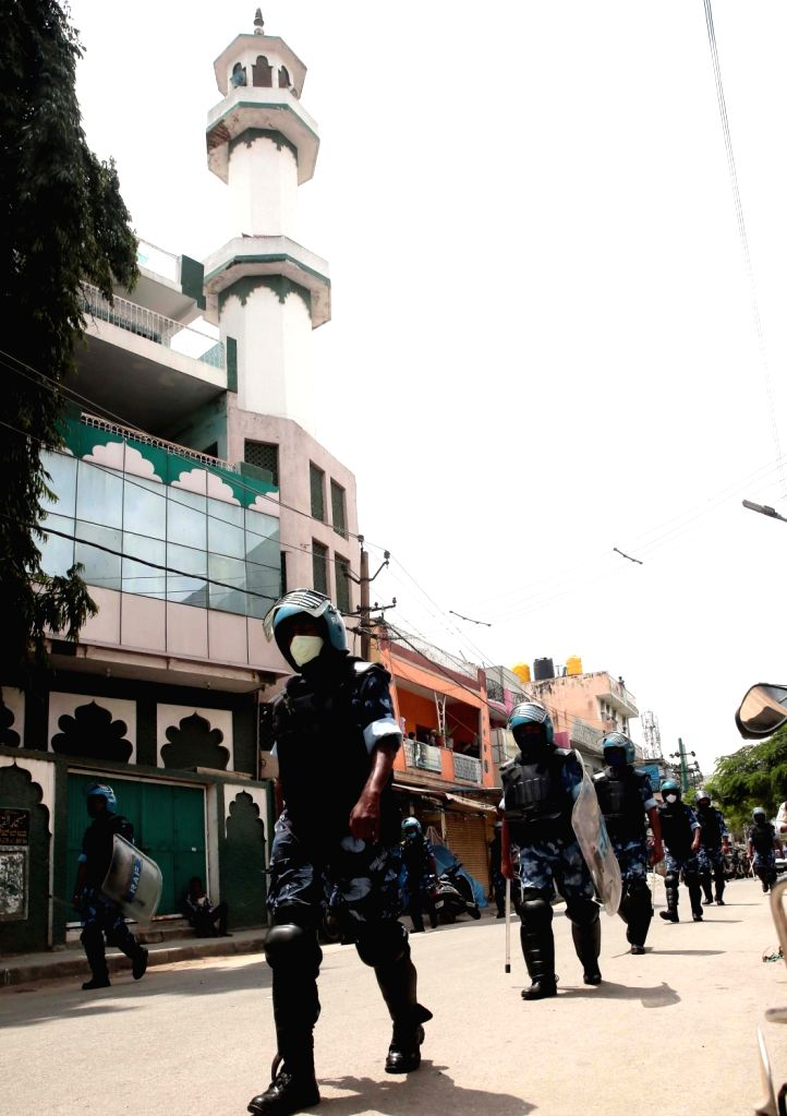 Rapid Action Firce (RAF) personnel conduct a flag march in the riot-hit areas of East Bengaluru on Aug 13, 2020. The total number of arrests in connection with the Bengaluru riots on ...
