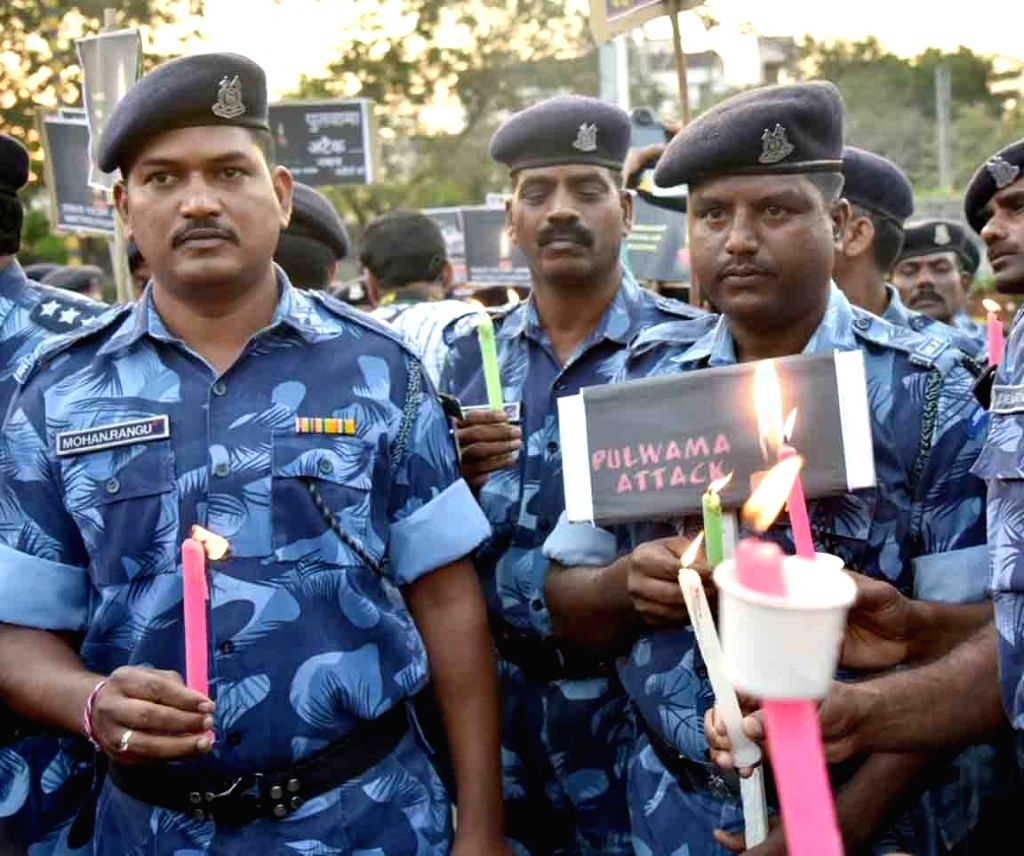 Rapid Action Force personnel take out a candle light rally to pay tribute to militant attack on a CRPF convoy in Jammu and Kashmir's Pulwama district in which 49 soldiers lost their lives; ...
