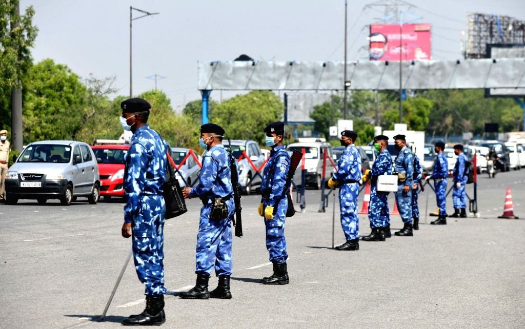 Rapid Action Force personnel wearing protective mask at the Delhi-Noida Border checkpoint during the extended nationwide lockdown imposed to mitigate the spread of coronavirus; on Apr 22, ...