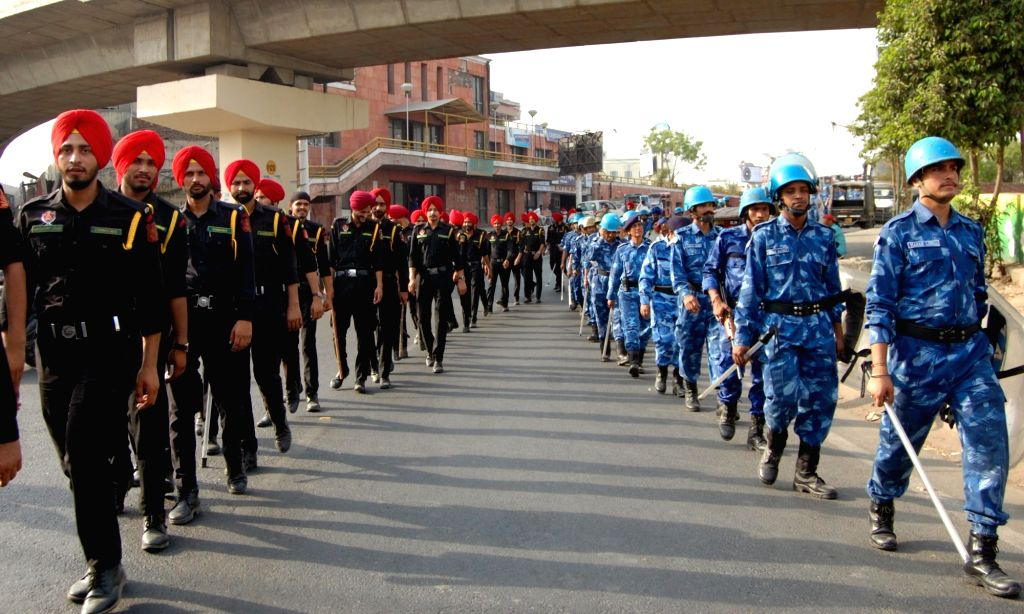 Rapid Action Force (RAF) and Punjab Police personnel conduct flag march ahead of the 34th anniversary Operation Blue Star in Amritsar, on June 3, 2018.