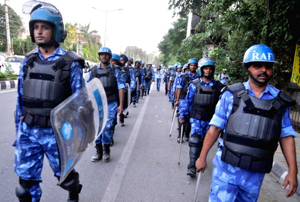Rapid Action Force (RAF) personnel conduct flag march in Amritsar ahead of anniversary of Operation Bluestar on June 2, 2017.