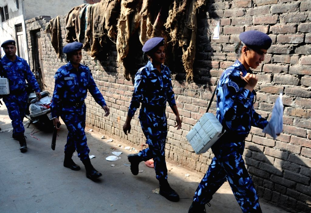 Rapid Action Force (RAF) personnel conduct flag march in Amritsar on April 1, 2018. Several Dalit groups have called for a Bharat Bandh against the dilution of Scheduled Castes-Scheduled ...