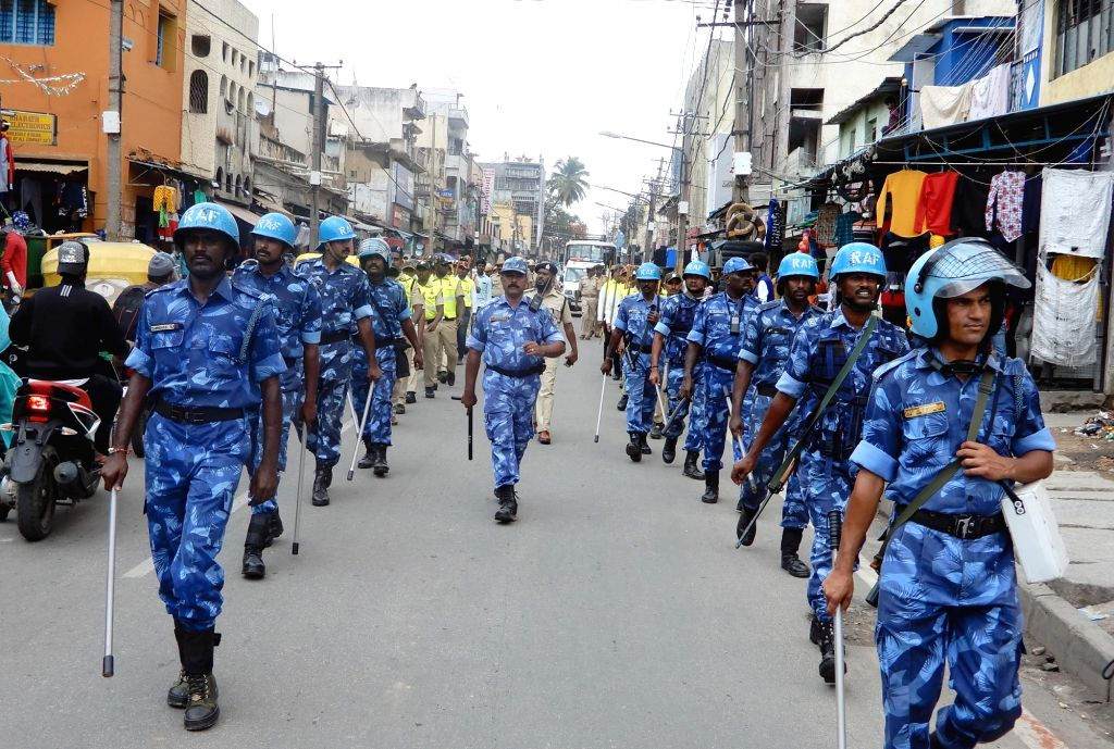 Rapid Action Force (RAF) personnel conduct flag march ahead of Ganesha idol immersion ceremony, in Bengaluru on Sept 15, 2018.