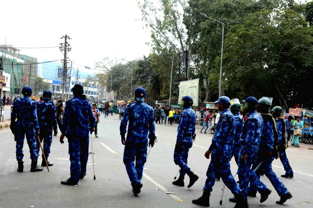 Rapid Action Force (RAF) personnel deployed as during a demonstration after a cake shop owner Purushotttam Kumar who was shot dead by unidentified bike-borne armed criminals after he tried to ... - Purushotttam Kumar