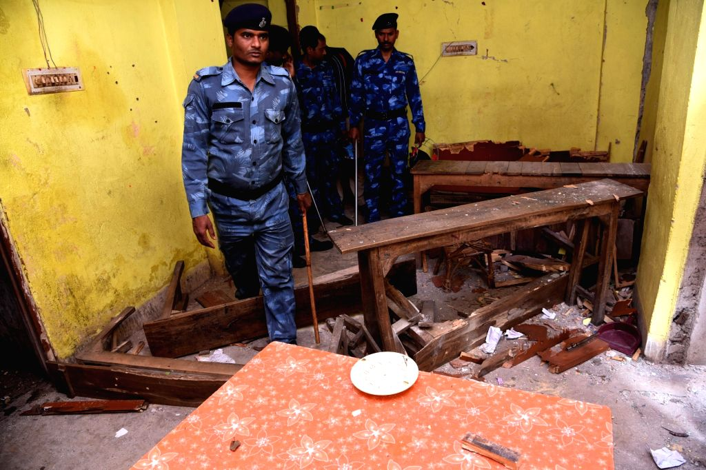 Rapid Action Force (RAF) personnel inspect the site where at least six people were injured in an explosion near Gandhi Maidan area of Patna on Feb 10, 2020. The explosion took place in a house ...