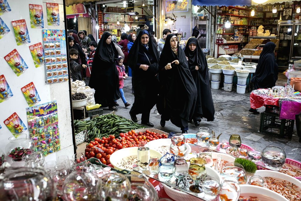 RASHT, March 13, 2017 - People shop at the old bazaar in Rasht city, north Iran, March 12, 2017, ahead of Nowruz, the Iranian New Year. Nowruz marks the first day of spring and the beginning of the ...
