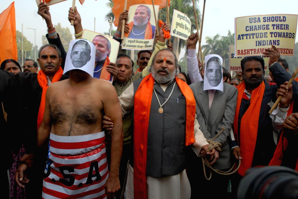 Rashtrawadi Shiv Sena activists take out a rally to protest against humiliation of Indian Deputy Consul-General, near American Embassy in New York Devyani Khobragade in New Delhi on Dec.18, 2013.