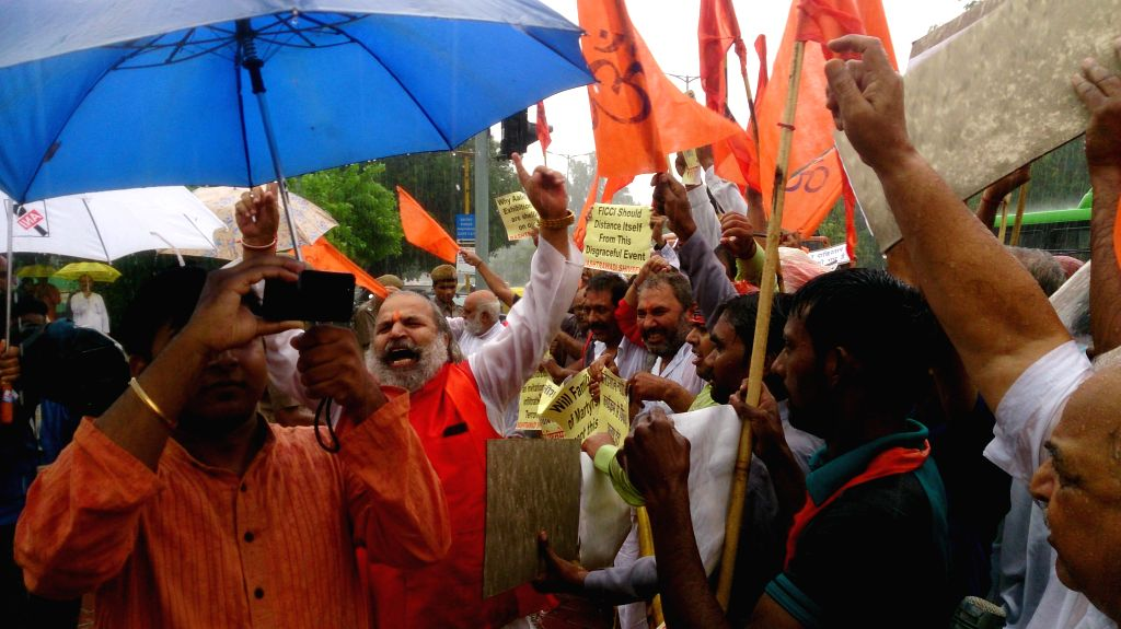 Rashtrawadi Shivsena workers led by their chief Jai Bhagwan Goyal demonstrate against `Alishan Pakistan` exhibition which is being held at Pragati Maidan of New Delhi on Sept 11, 2014.