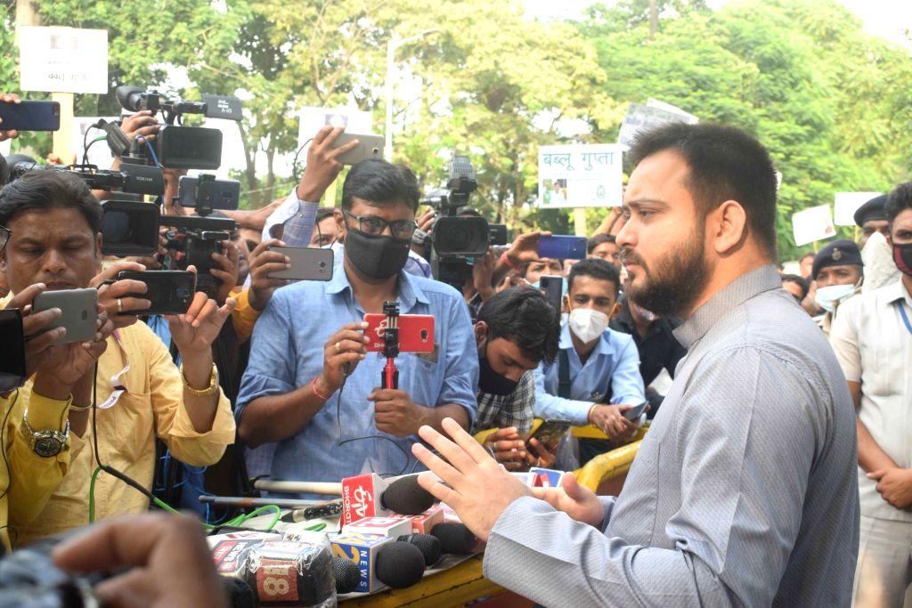 Rashtriya Janata Dal (RJD) leader Tejashwi Yadav talks to the media outside his bungalow ahead of Bihar Assembly elections, in Patna on Oct 8, 2020. - Tejashwi Yadav
