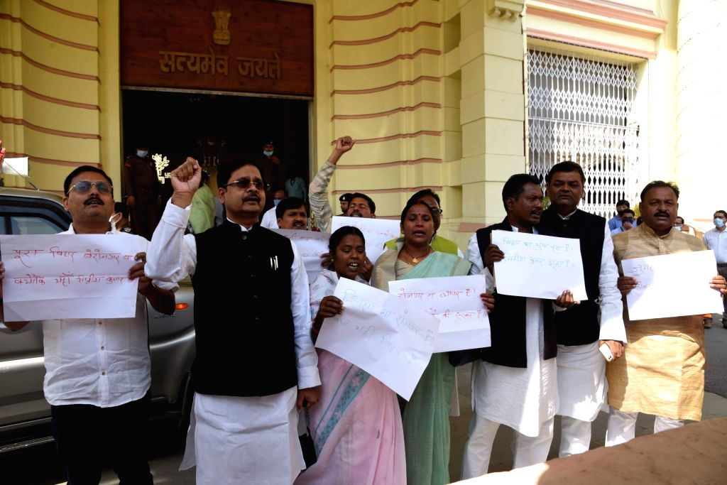 Rashtriya Janata Dal (RJD) legislators stage protest for rozgar issue at Bihar Assembly during an ongoing budget session, in Patna on Wednesday 03rd March, 2021.